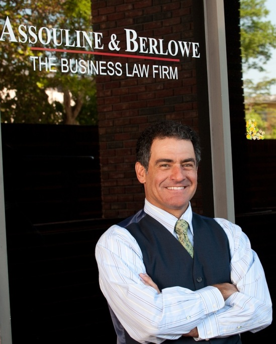 048 Eric in Front of Assouline   Berlowe Sign at Grove office (00150877)